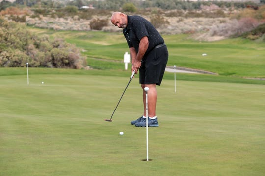 Grant Fuhr, former ice hockey goaltender in the National Hockey League, putts at Desert Dunes Golf Club in Desert Hot Springs on Friday, December 21, 2018.