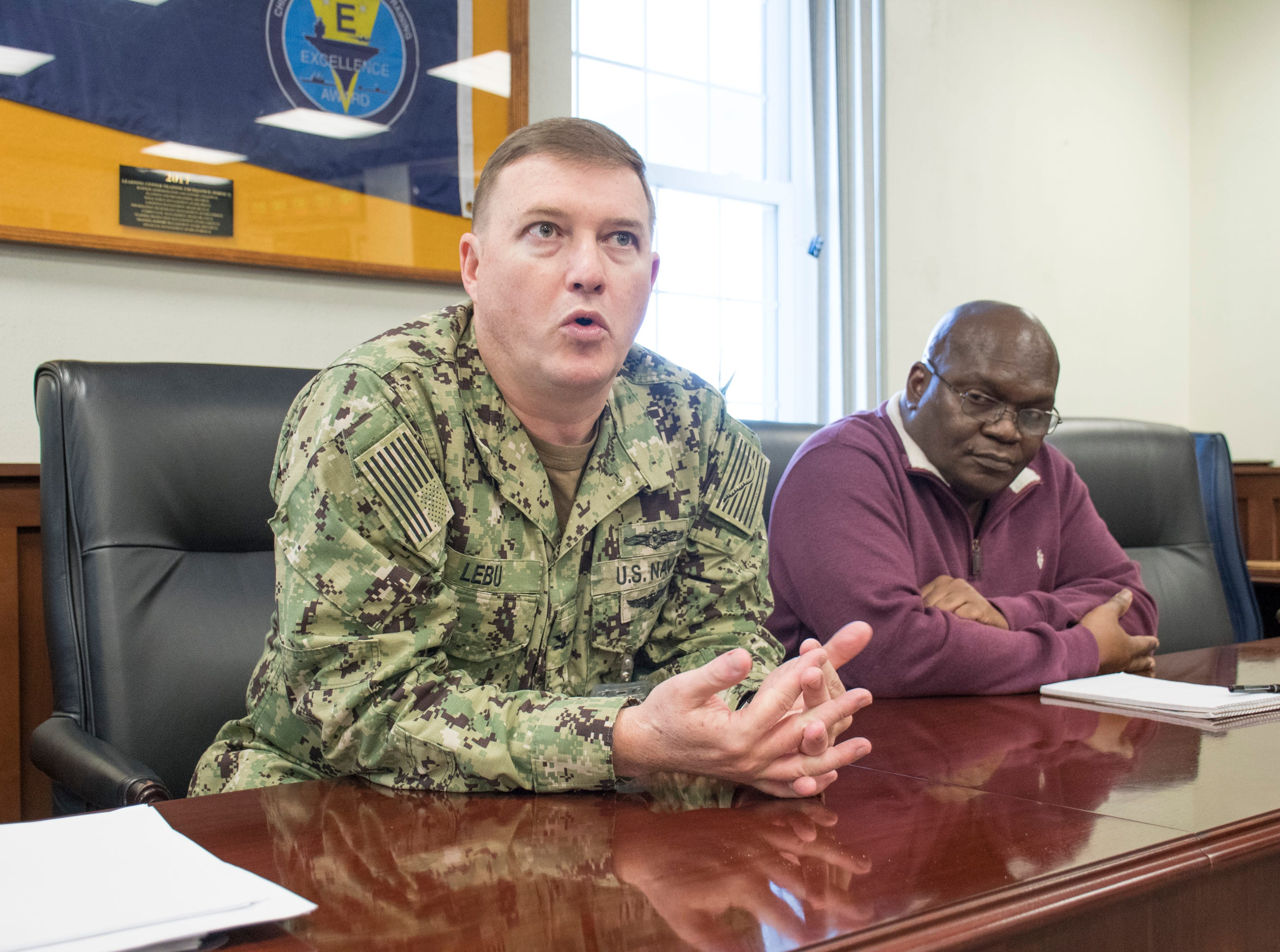Capt. Mike Lebu, Cyber Mission Force program manager, left, talks about the building projects and expansion underway at NAS Pensacola Corry Station in Pensacola on Thursday, January 10, 2019.