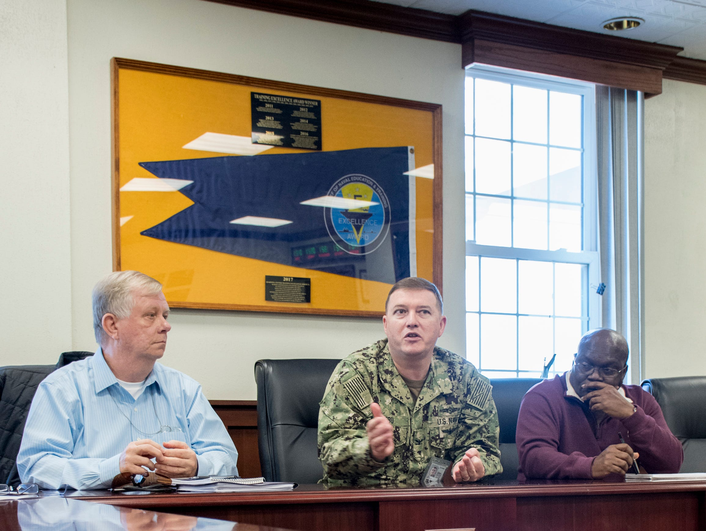 Capt. Mike Lebu, Cyber Mission Force program manager, center, talks about the building projects and expansion underway at NAS Pensacola Corry Station in Pensacola on Thursday, January 10, 2019.