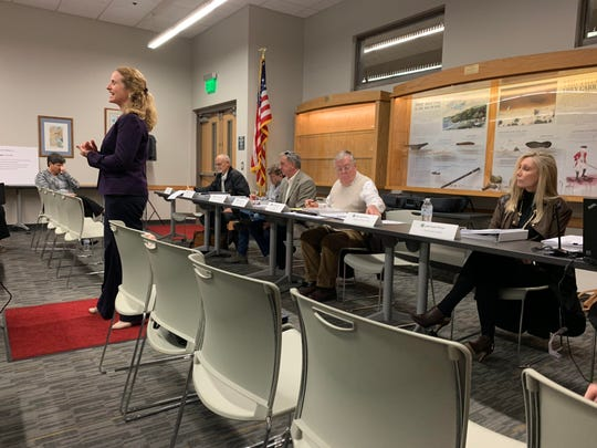 City Manager Samantha Abell, standing, speaks to the crowd gathered on Thursday night for the public forum about the proposed Blueways project.