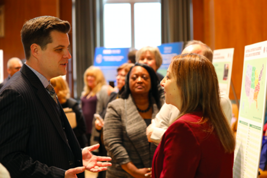 Rep. Matt Gaetz talks Thursday with Eman El-Sheikh, director of the University of West Florida Center for Cybersecurity, at the Cybersecurity Centers of Academic Excellence Grant Showcase in Washington D.C.