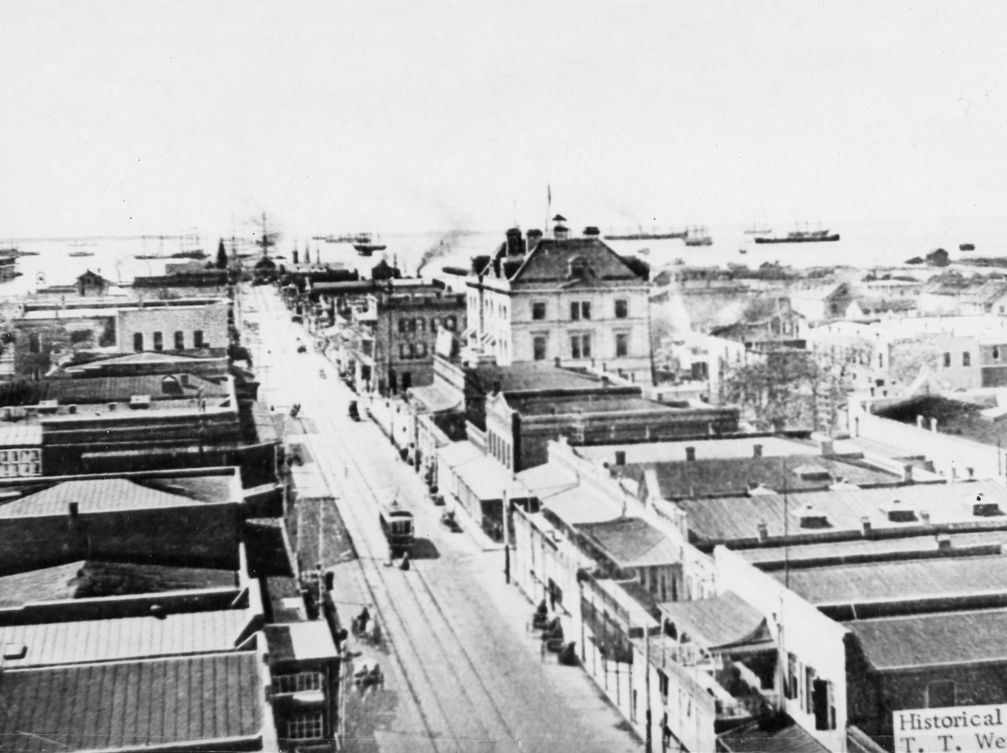 View of south Palafox Street and the Harbour North Atlantic Squadron at Anchor in 1912.
