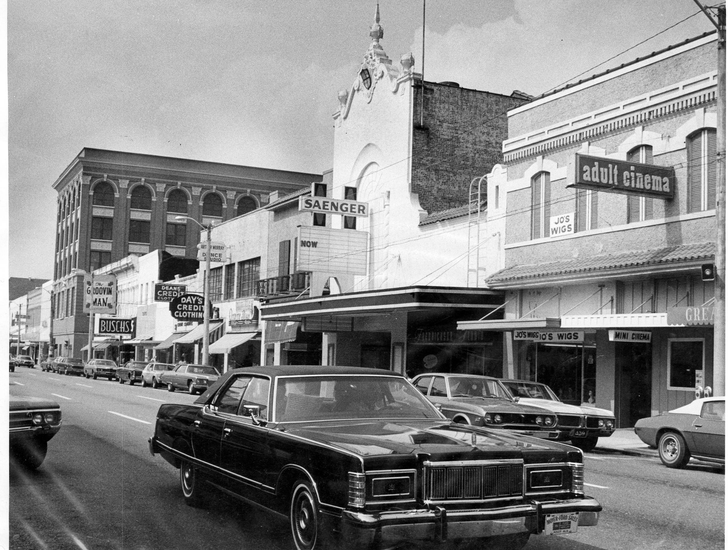 Saenger Theatre and other businesses on Palafox Street in 1970s.