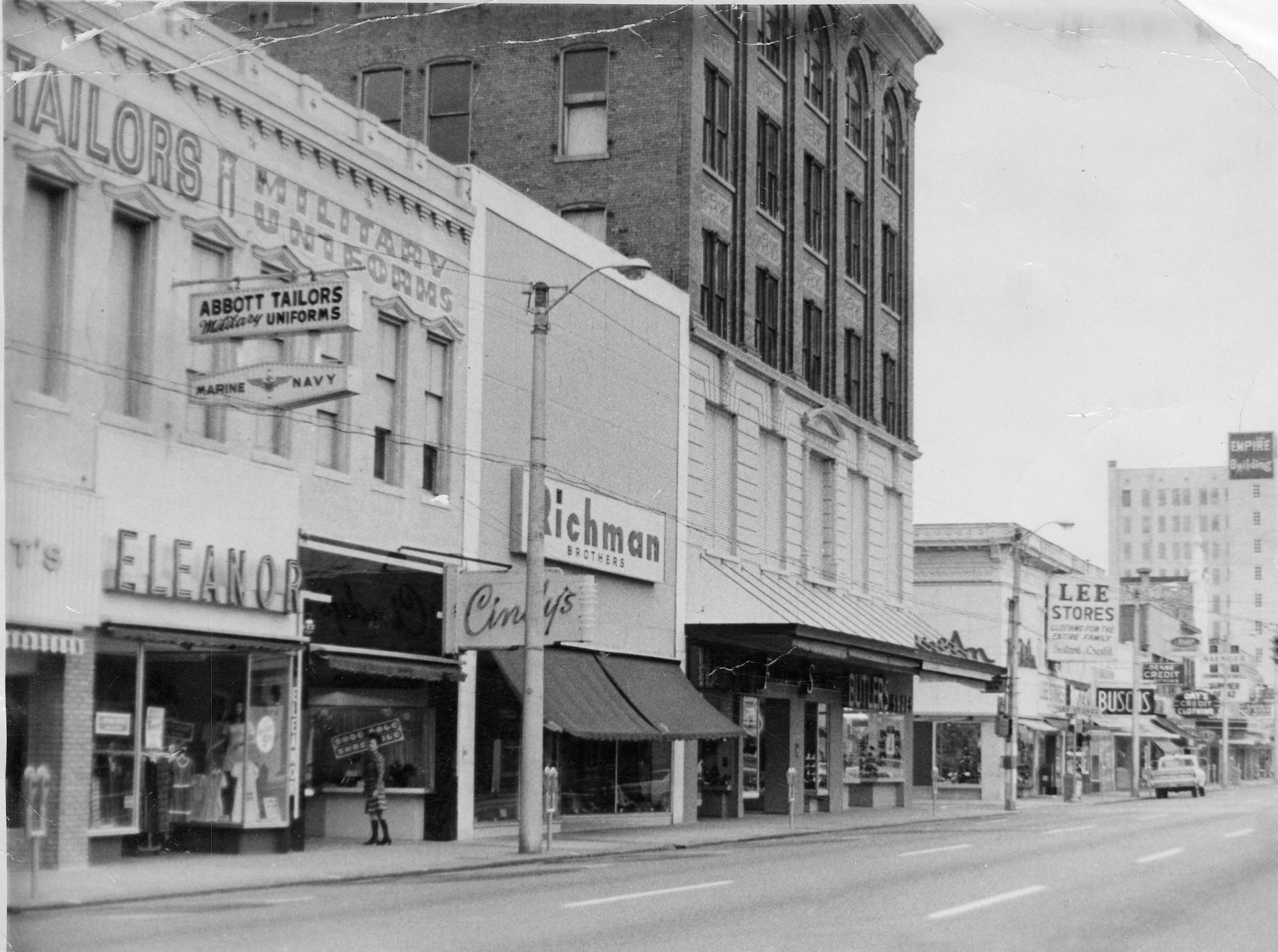 Several stores on Palafox Street, late 1960s.