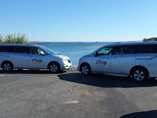 Two zTrip vehicles are pictured parked near the 17th Street Public Boat Ramp in Pensacola.