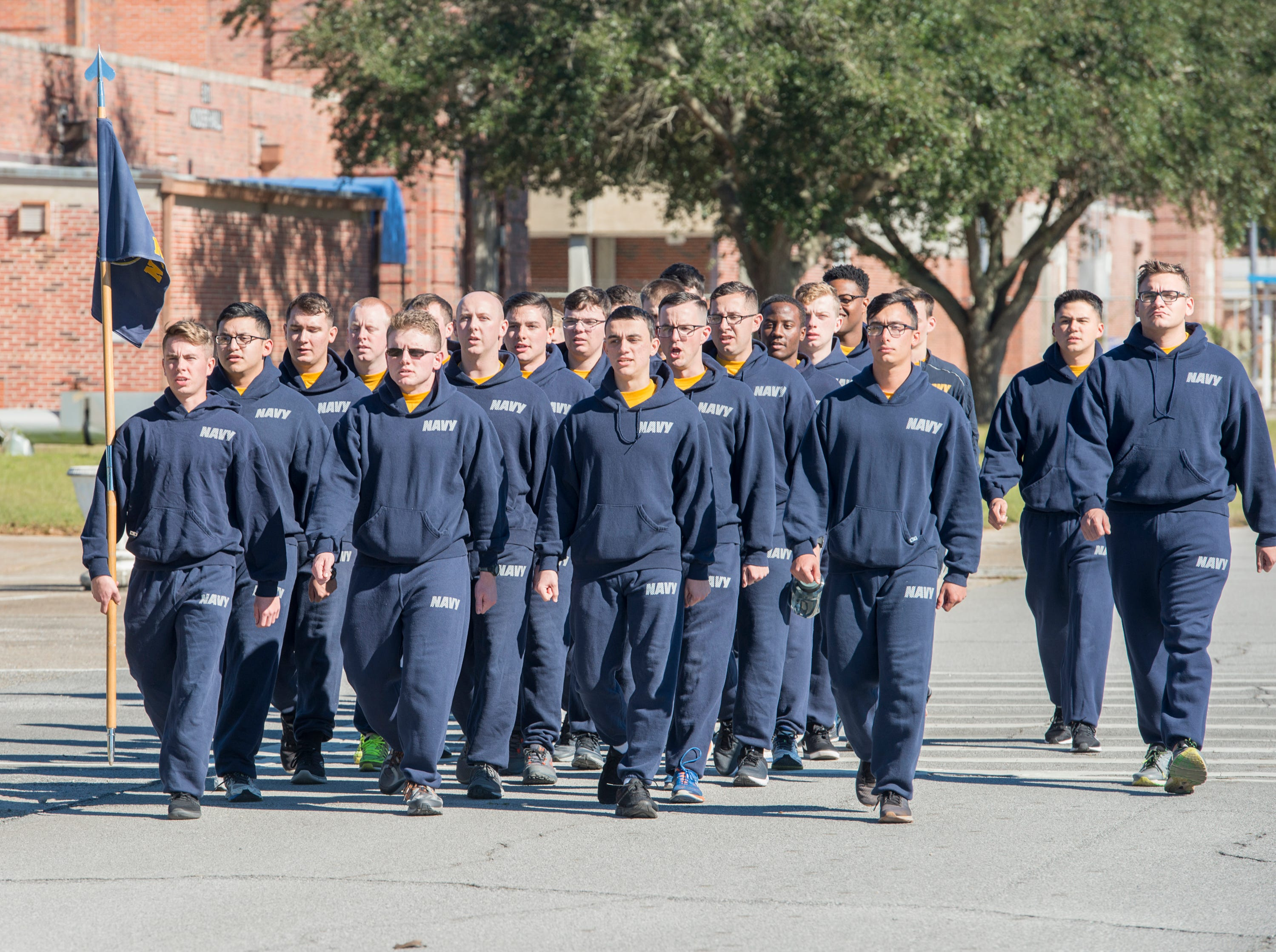 Sailors march in between classes at NAS Pensacola Corry Station in Pensacola on Thursday, January 10, 2019.