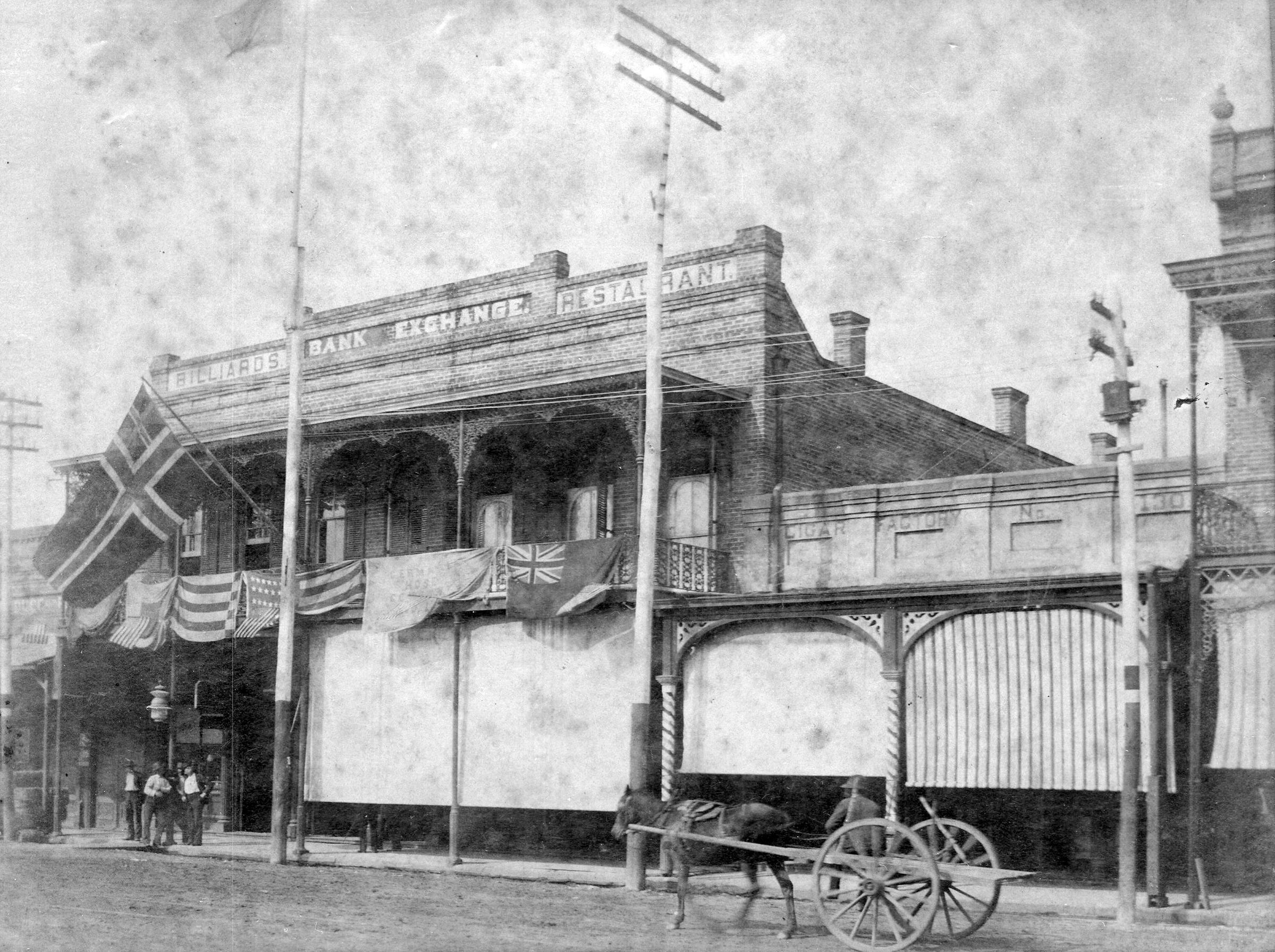 Building on Palafox Street, across from the plaza in 1898.