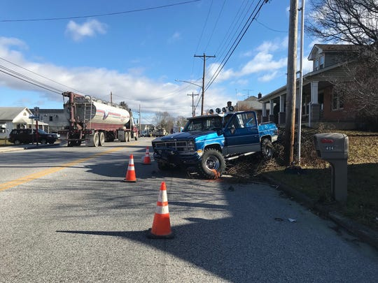 The Adams County Coroner is at the scene of this car crash in the 400 block of West King Street in Abbottstown on Jan. 10.