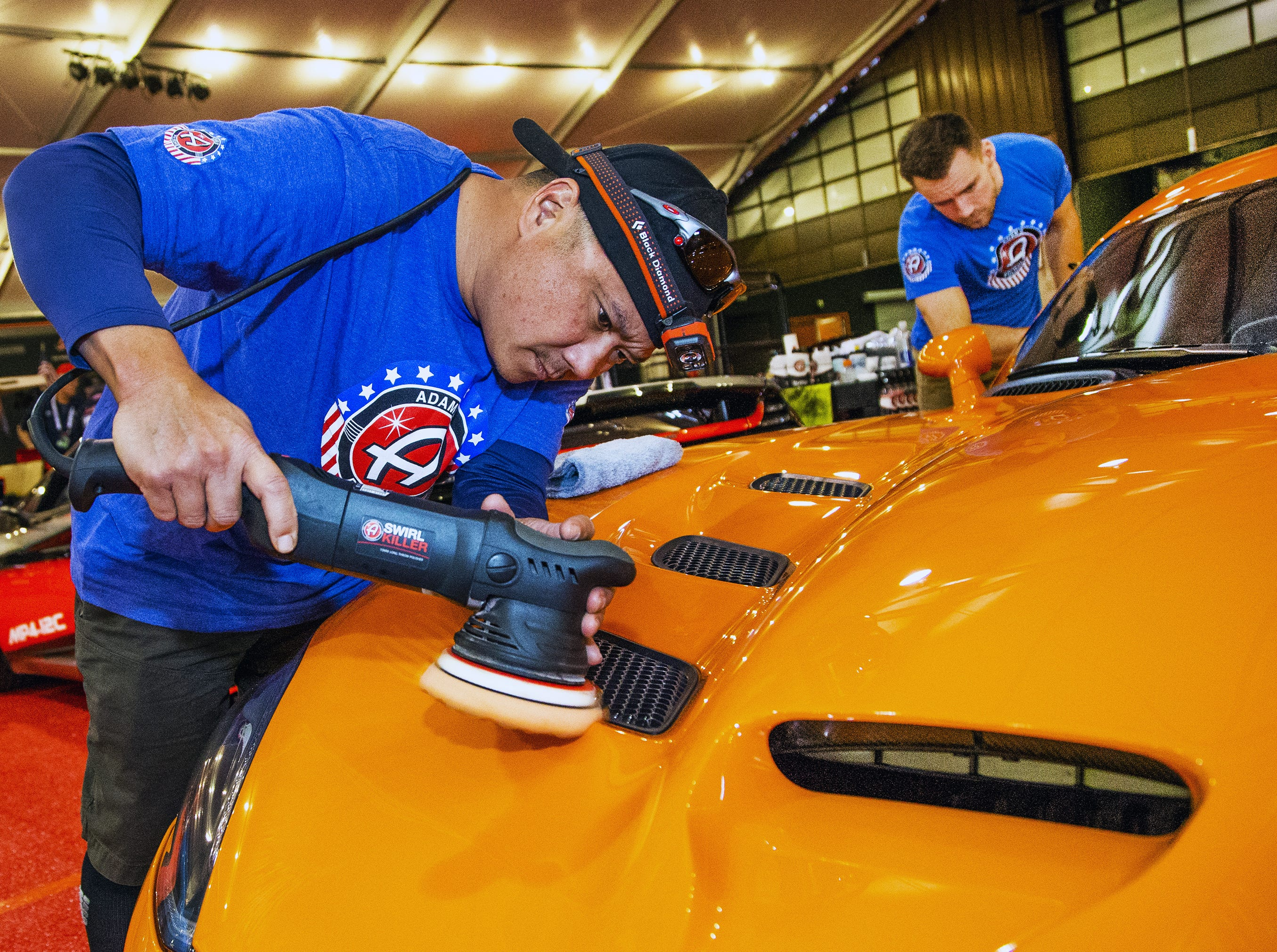 Detailers Kerwin Miyashiro (left) and Collin Albert of Adam's Polishes buff out a 2017 Dodge Viper ACR TA at the 48th Annual Barrett-Jackson Scottsdale Collector Car Auction at WestWorld that runs from January 12-20, 2019.