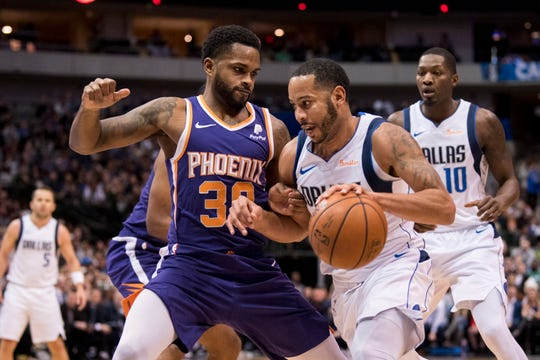 Jan 9, 2019; Dallas, TX, USA; Dallas Mavericks guard Devin Harris (34) drives to the basket past Phoenix Suns guard Troy Daniels (30) during the second quarter at the American Airlines Center. Mandatory Credit: Jerome Miron-USA TODAY Sports