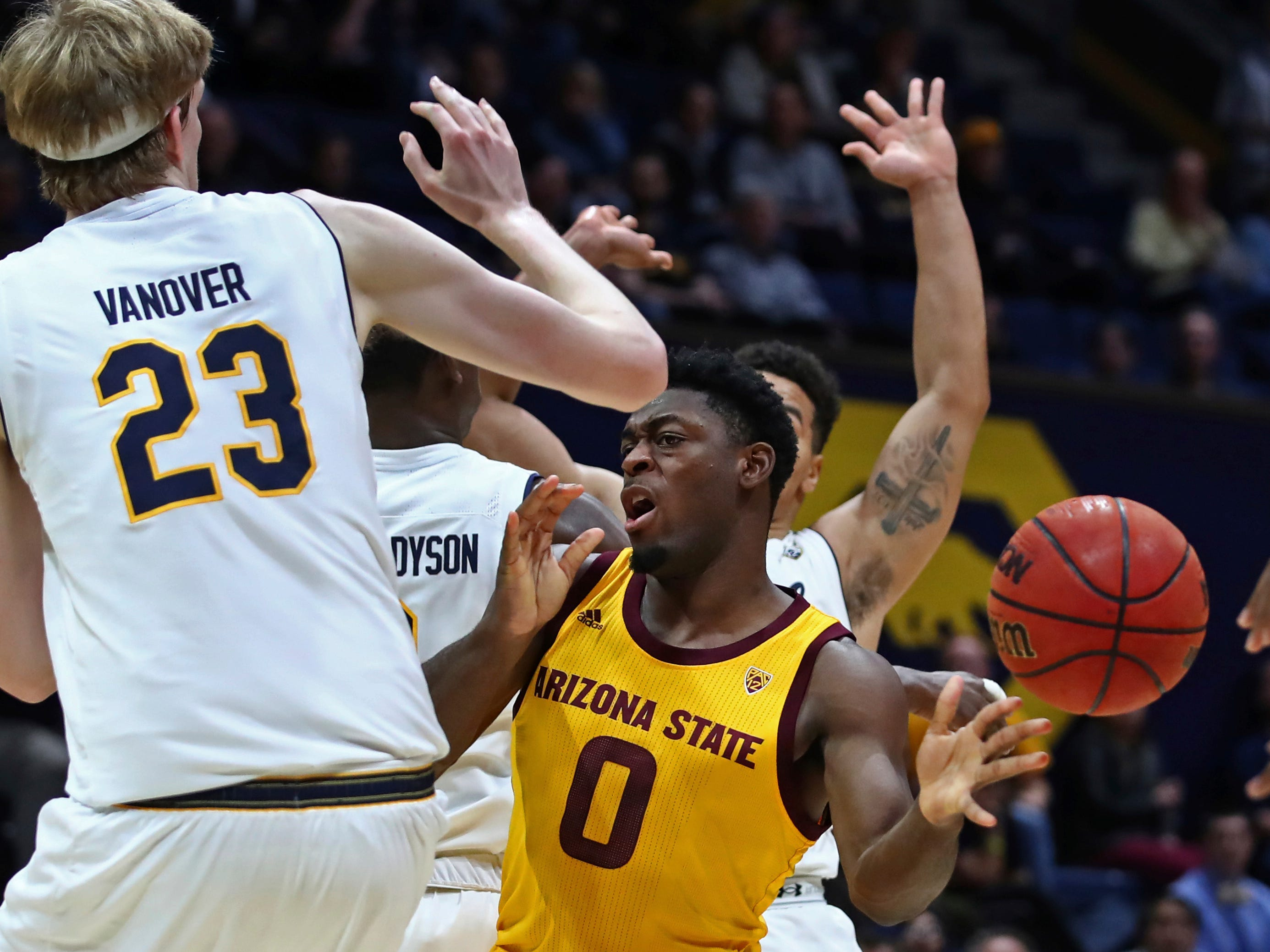 Arizona State's Luguentz Dort, right, passes the ball away from California's California's Connor Vanover (23) during the first half of an NCAA college basketball game Wednesday, Jan. 9, 2019, in Berkeley, Calif. (AP Photo/Ben Margot)