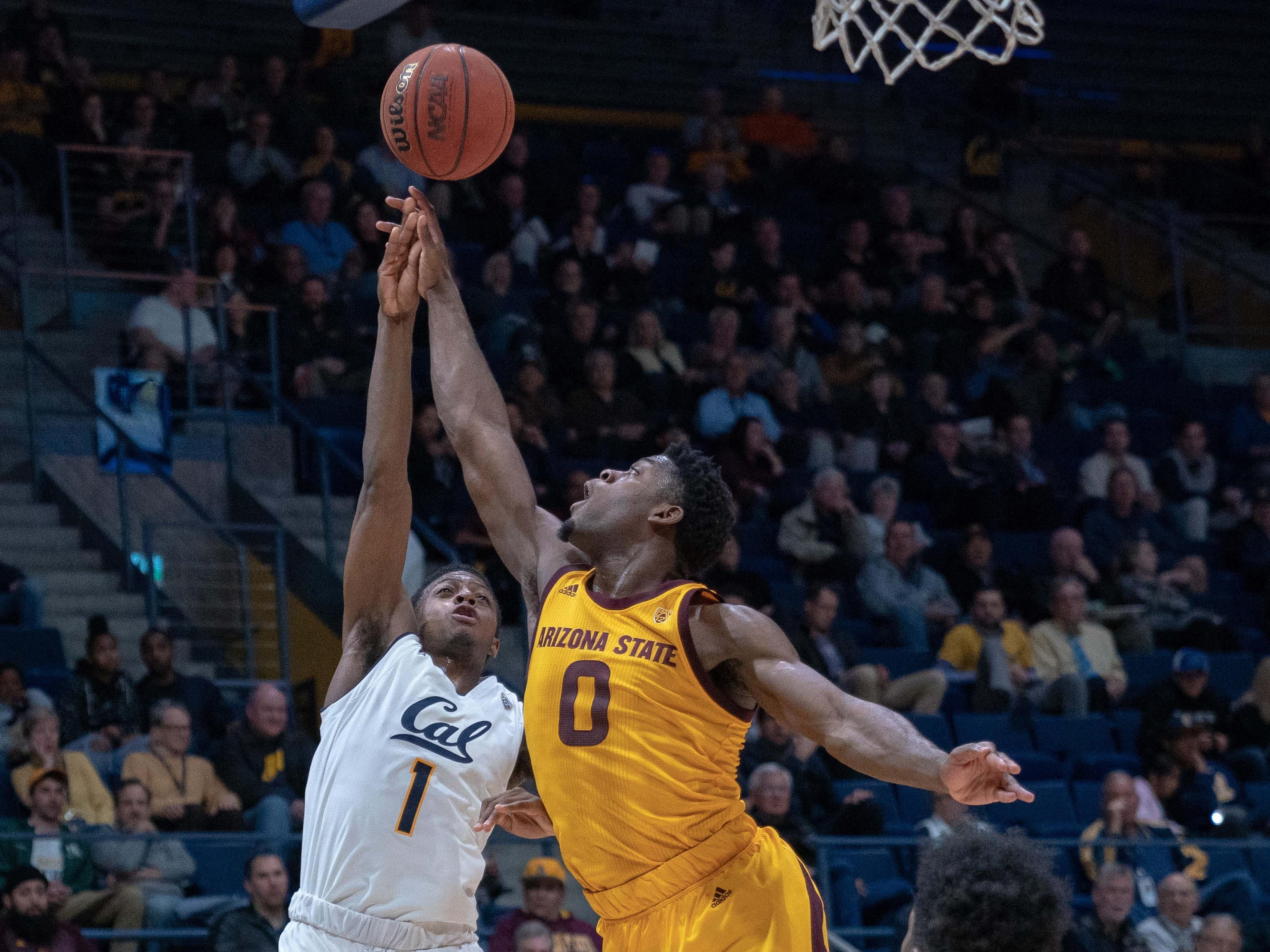 Jan 9, 2019; Berkeley, CA, USA; California Golden Bears guard Darius McNeill (1) shoots the basketball against Arizona State Sun Devils guard Luguentz Dort (0) during the first half at Haas Pavilion. Mandatory Credit: Neville E. Guard-USA TODAY Sports