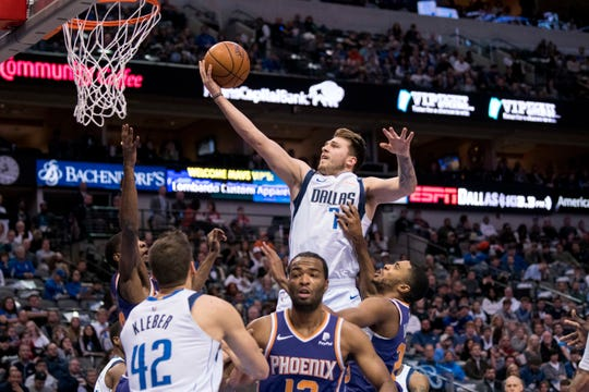 Jan 9, 2019; Dallas, TX, USA; Dallas Mavericks forward Luka Doncic (77) drives to the basket past the Phoenix Suns during the first quarter at the American Airlines Center. Mandatory Credit: Jerome Miron-USA TODAY Sports