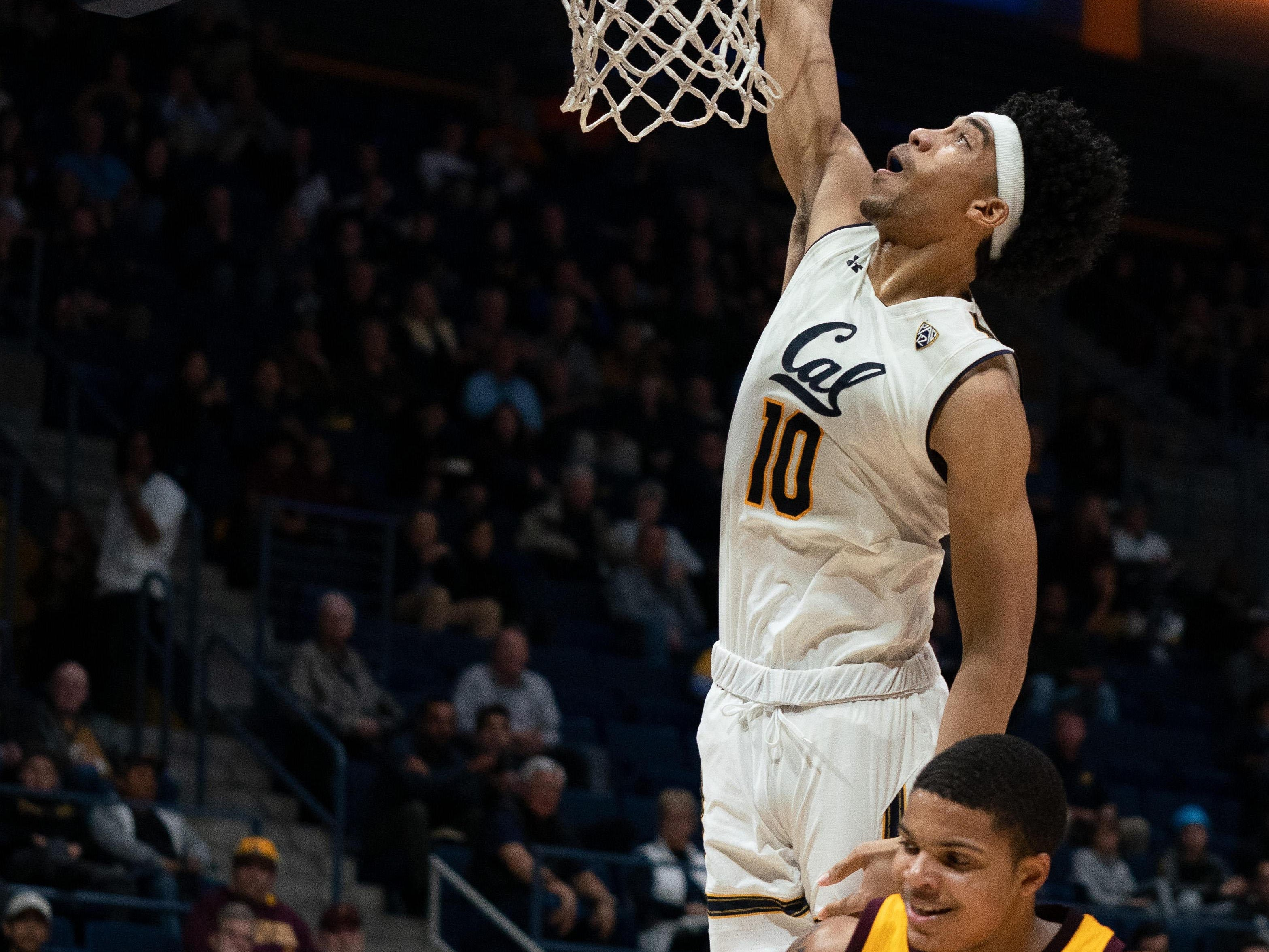 Jan 9, 2019; Berkeley, CA, USA; California Golden Bears forward Justice Sueing (10) dunks the basketball against Arizona State Sun Devils guard Rob Edwards (2) during the first half at Haas Pavilion. Mandatory Credit: Neville E. Guard-USA TODAY Sports