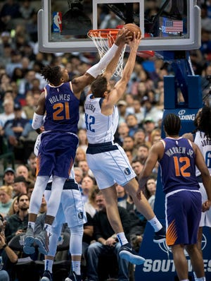Jan 9, 2019; Dallas, TX, USA; Phoenix Suns forward Richaun Holmes (21) and Dallas Mavericks forward Maximilian Kleber (42) fight for the rebound during the second quarter at the American Airlines Center. Mandatory Credit: Jerome Miron-USA TODAY Sports