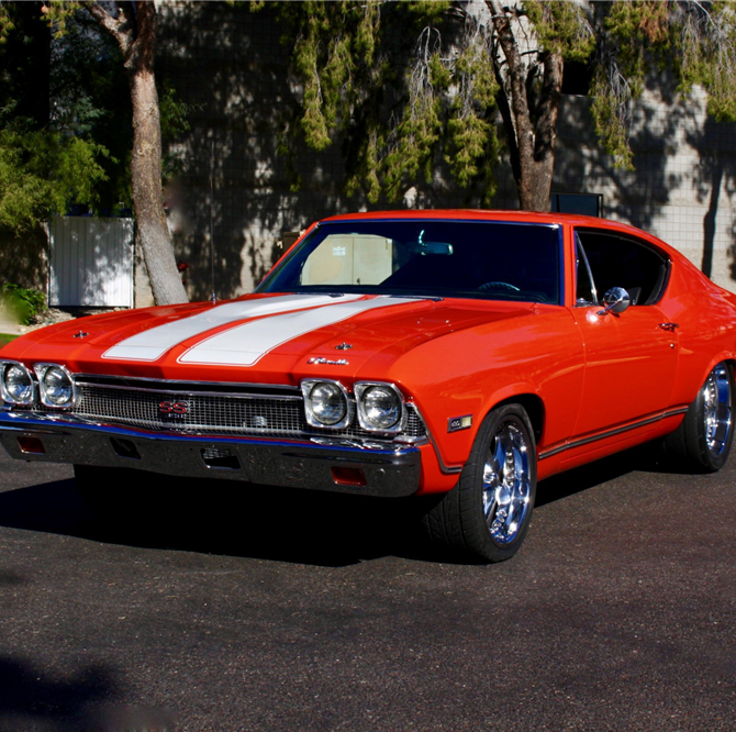 Larry Fitzgerald is auctioning off 3 cars at Barrett-Jackson. Is it a sign?