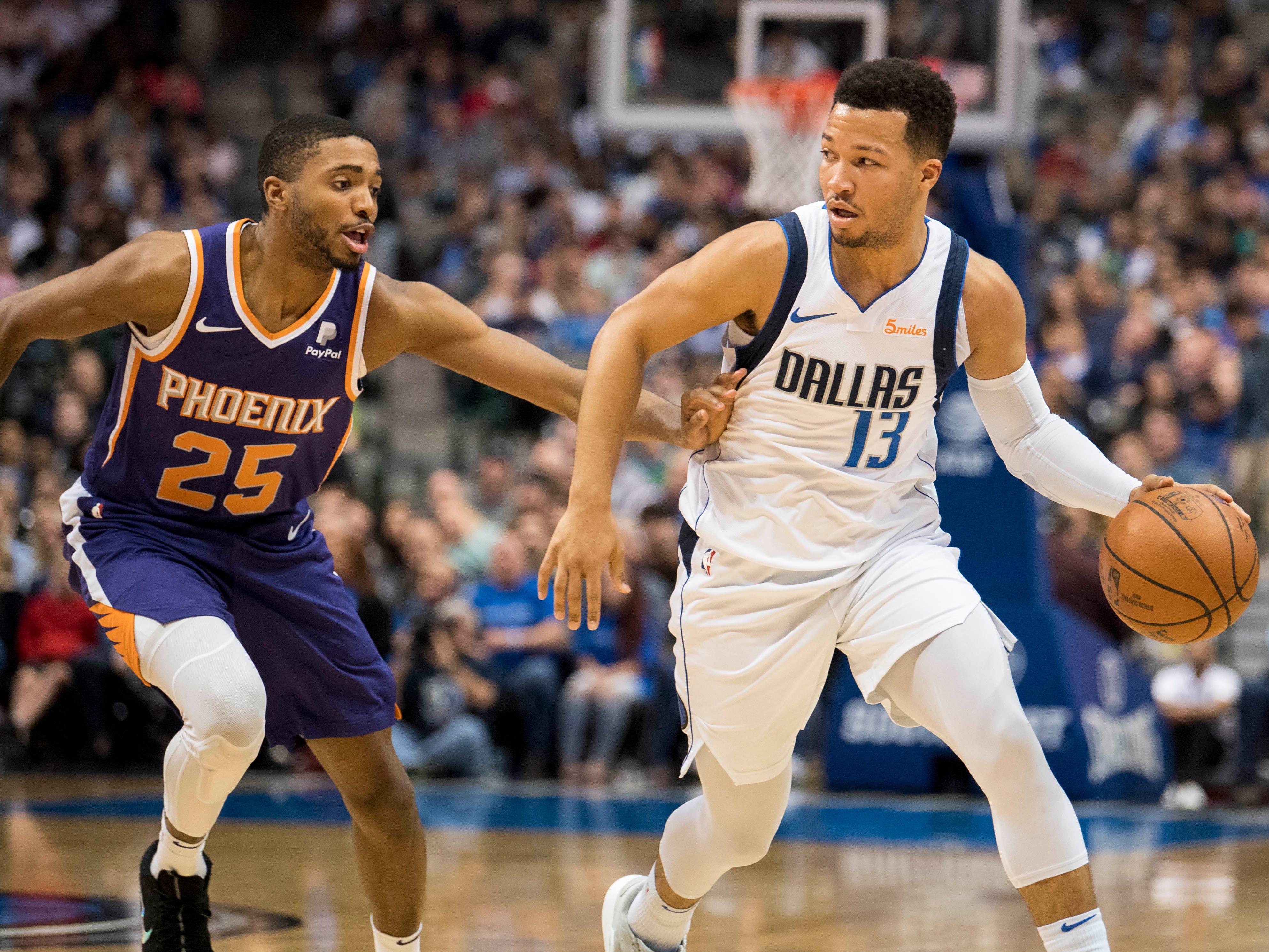 Jan 9, 2019; Dallas, TX, USA; Phoenix Suns forward Mikal Bridges (25) guards Dallas Mavericks guard Jalen Brunson (13) during the second quarter at the American Airlines Center. Mandatory Credit: Jerome Miron-USA TODAY Sports