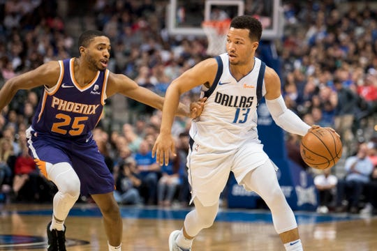 Jan 9, 2019; Dallas, TX, USA; Phoenix Suns forward Mikal Bridges (25) guards Dallas Mavericks guard Jalen Brunson (13) during the second quarter at the American Airlines Center. Mandatory Credit: Jerome Miron-USA TODAY Sports