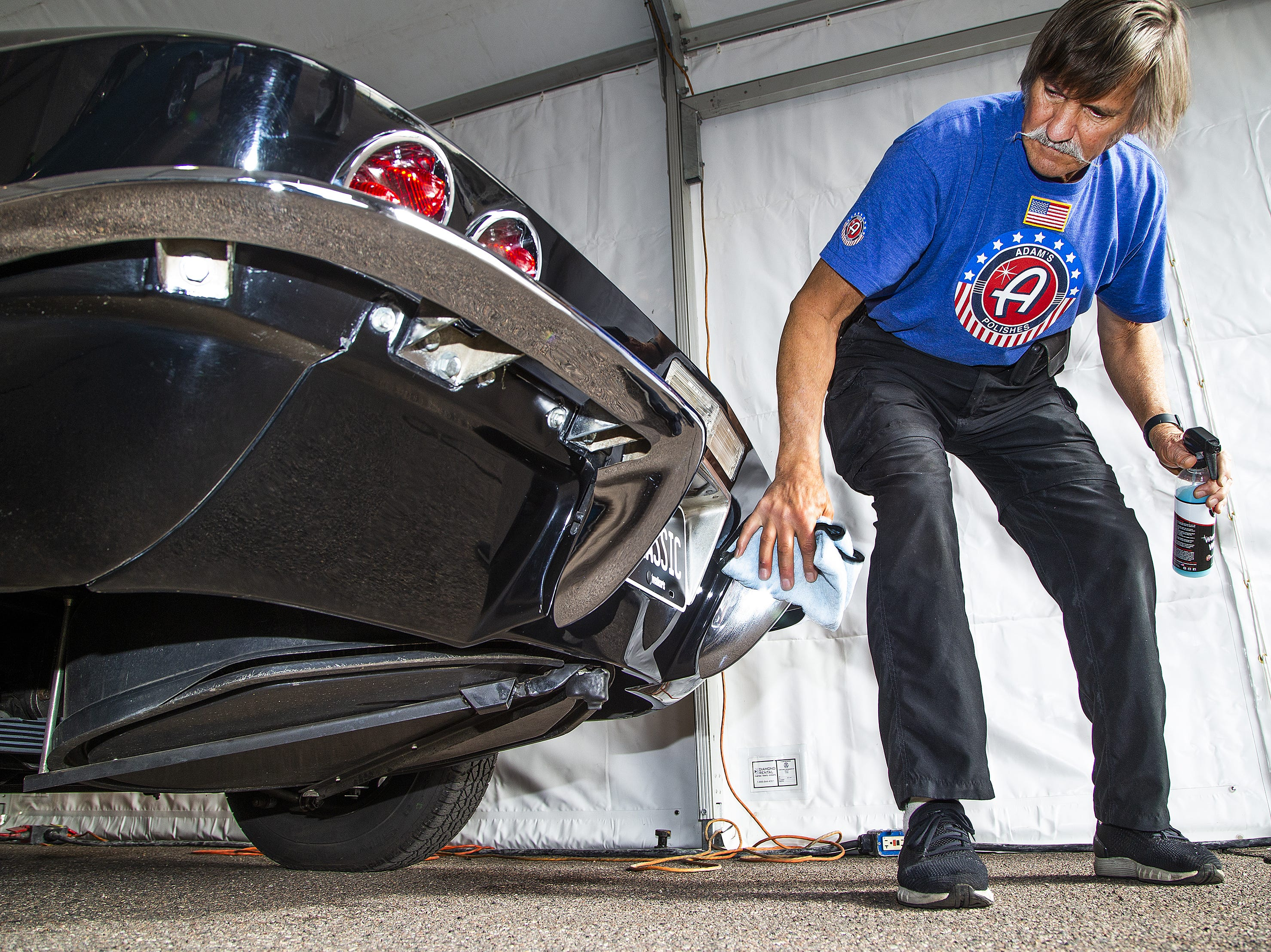 Detailer Greg Mirich wipes down a 1967 427 Corvette Stingray convertible in preparation for the 48th Annual Barrett-Jackson Scottsdale Collector Car Auction at WestWorld that runs from January 12-20, 2019.