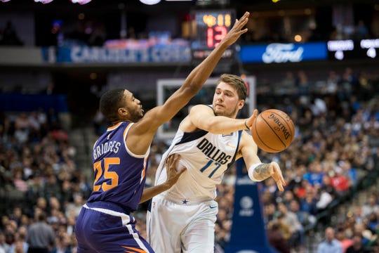 Suns forward Mikal Bridges pressures Mavericks forward Luka Doncic during a game Jan. 9 at American Airlines Center.
