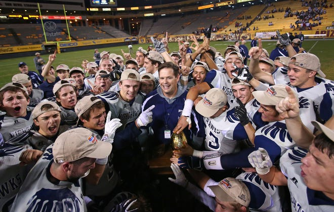 Matt Johnson and his team celebrate their state title in 2012.
