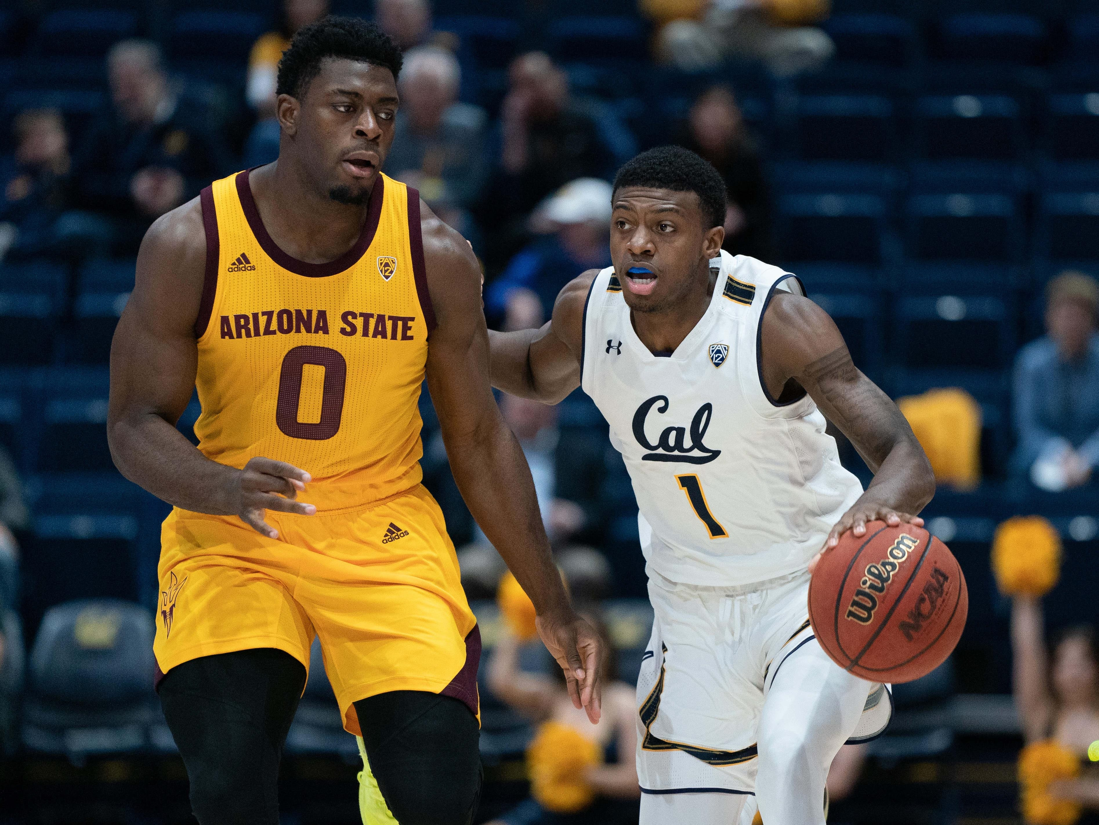 Jan 9, 2019; Berkeley, CA, USA; California Golden Bears guard Darius McNeill (1) dribbles against Arizona State Sun Devils guard Luguentz Dort (0) during the first half at Haas Pavilion. Mandatory Credit: Neville E. Guard-USA TODAY Sports