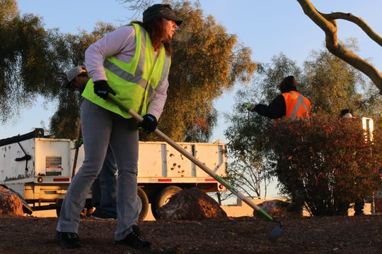 Virginia Gibbons does landscape work on Grand Canal Linear Park in Glendale as part of the new Glendale Works program.
