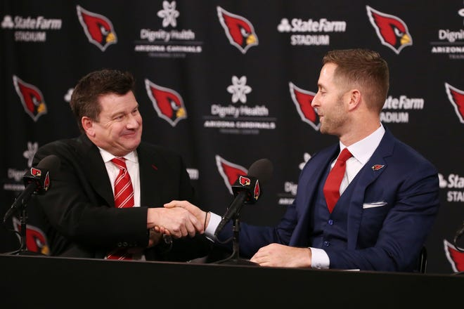 Arizona Cardinals president Michael Bidwill (left) introduces his new head coach Kliff Kingsbury during a press conference on Jan. 9 at the Cardinals Training Facility in Tempe, Ariz.