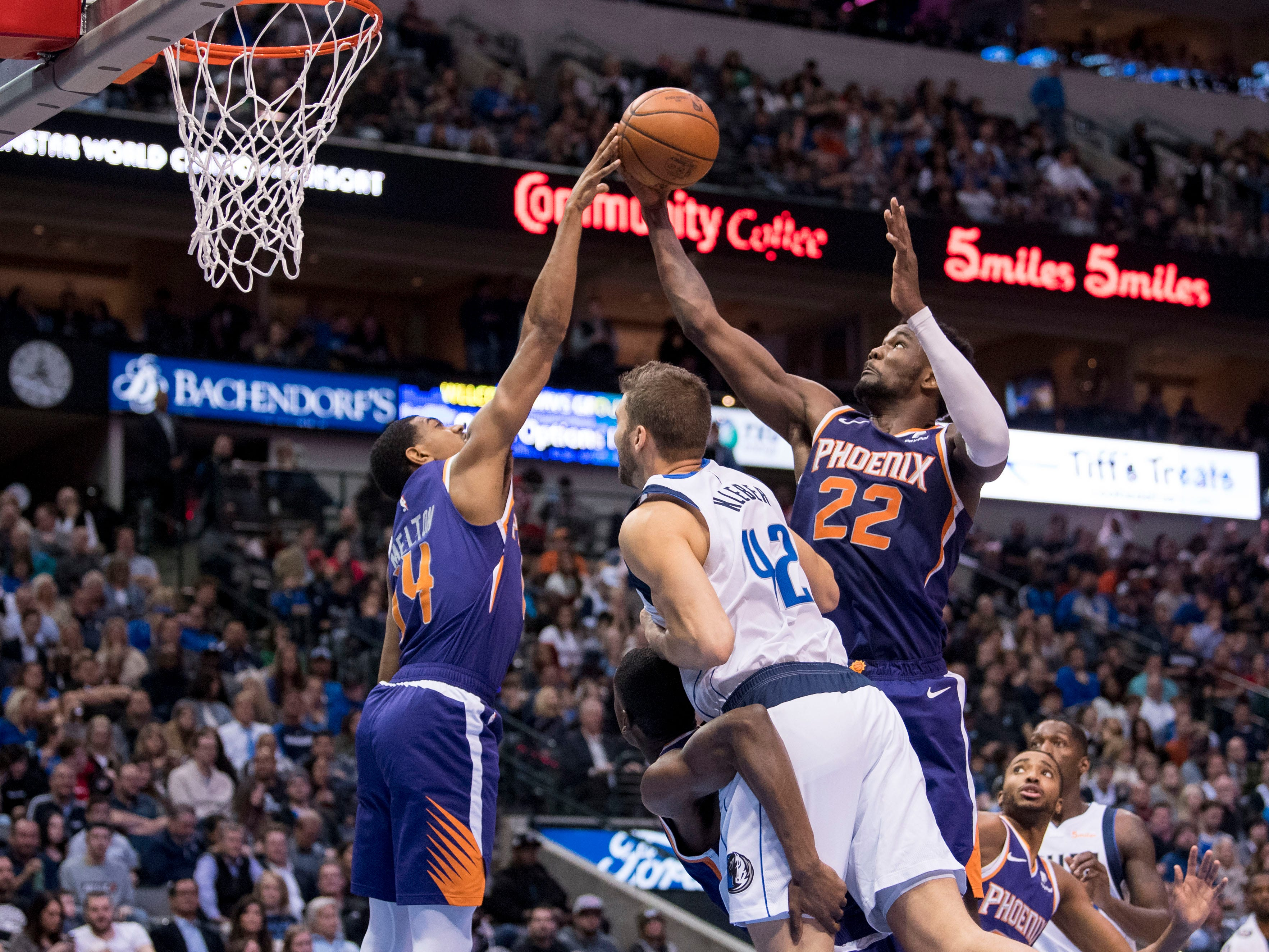 Jan 9, 2019; Dallas, TX, USA; Phoenix Suns guard De'Anthony Melton (14) and center Deandre Ayton (22) grab a rebound in front of Dallas Mavericks forward Maximilian Kleber (42) during the second quarter at the American Airlines Center. Mandatory Credit: Jerome Miron-USA TODAY Sports