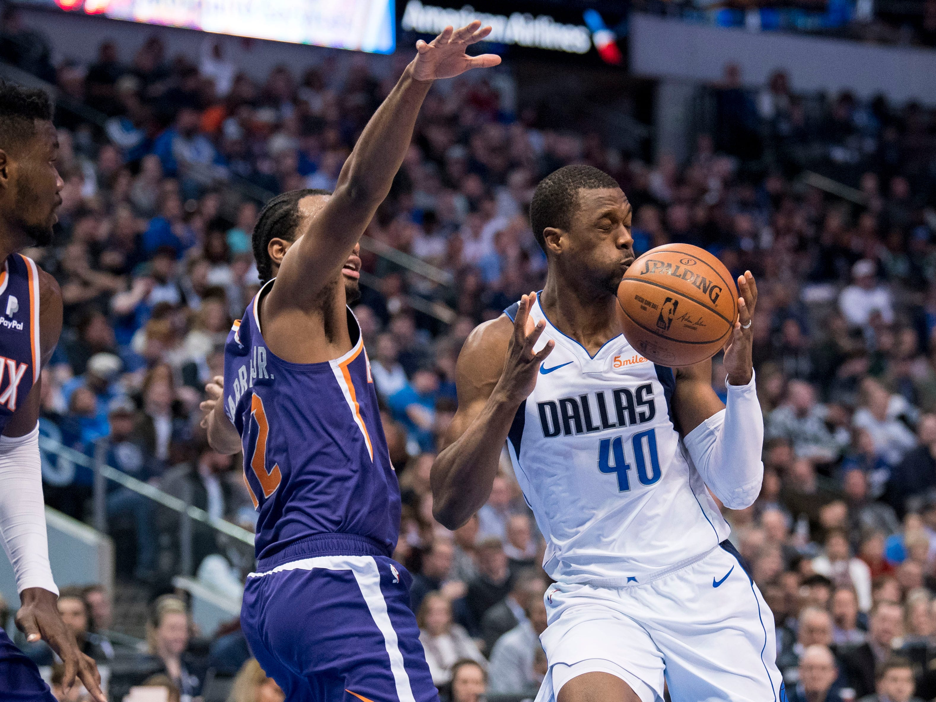 Jan 9, 2019; Dallas, TX, USA; Phoenix Suns forward T.J. Warren (12) defends against Dallas Mavericks forward Harrison Barnes (40) during the second quarter at the American Airlines Center. Mandatory Credit: Jerome Miron-USA TODAY Sports