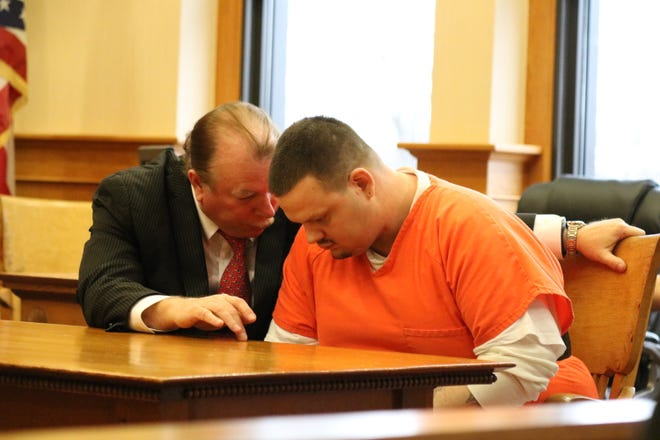 Defense attorney Howard Whitcomb, left, speaks with his client, Cody Habel, 27, who was sentenced to 33 years in prison after pleading guilty to the rape of a 5-year-old child.
