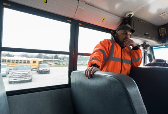 First Student safety manager Chad Vick waits inside a Port Huron Area School District bus Wednesday, Jan. 9, 2019 outside of Crull Elementary School. Vick says one of the most important traits for a bus driver to possess is the patience to deal with students.