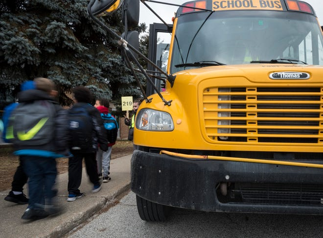 Crull Elementary students walk past a Port Huron Area School District bus Wednesday, Jan. 9, 2019 outside of Crull Elementary. First Student runs buses on 63 routes across 16 school buildings for the district, and is often hiring more drivers.