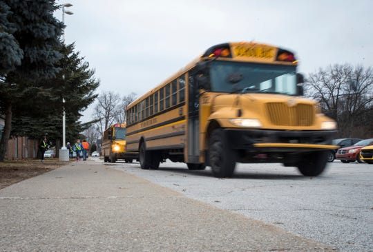 A Port Huron Area School District bus pulls away from Crull Elementary School Wednesday, Jan. 9, 2019 after loading up with students. First Student runs buses on 63 routes across 16 school buildings for the district, and is often hiring more drivers.
