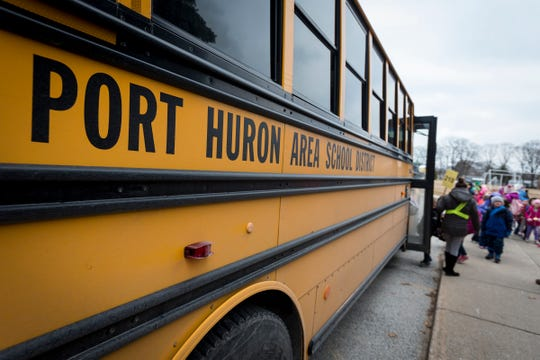 Students board a Port Huron Area School District bus Wednesday, Jan. 9, 2019 outside of Crull Elementary School. First Student runs buses on 63 routes across 16 school buildings for the district, and is often hiring more drivers.