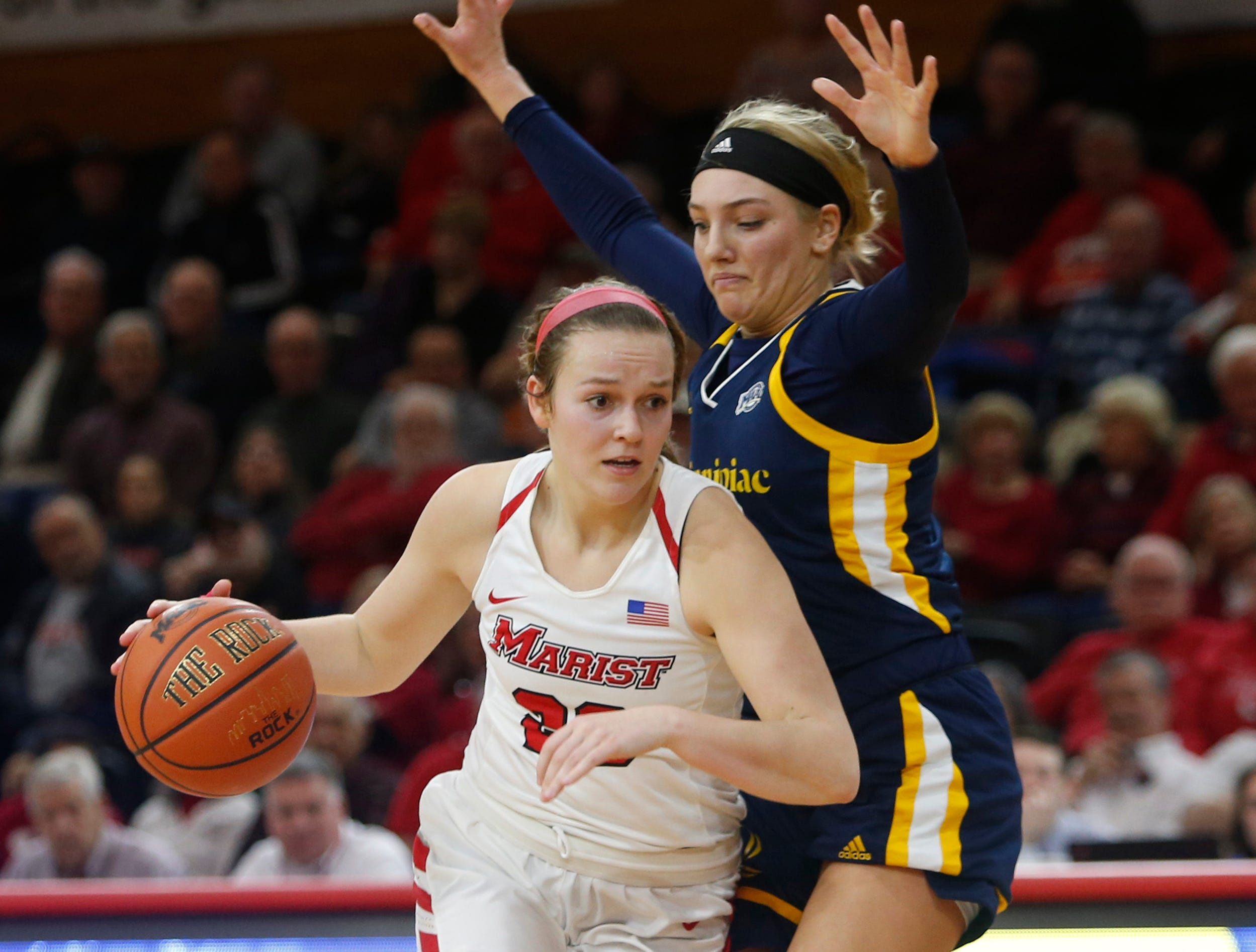 Marist's Rebekah Hand drives up court against Quinnipiac's Taylor Herd in Thursday's game.