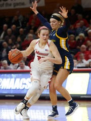 Marist's Rebekah Hand drives up court against Quinnipiac's Taylor Herd during a game this season at Marist.