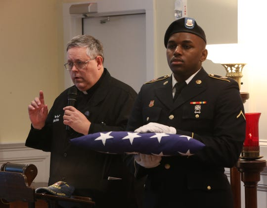 Father Karl Lindblad VA chaplain speaks during Thursday's memorial service for four veterans at Libby Funeral Home in Beacon on January 10, 2019.