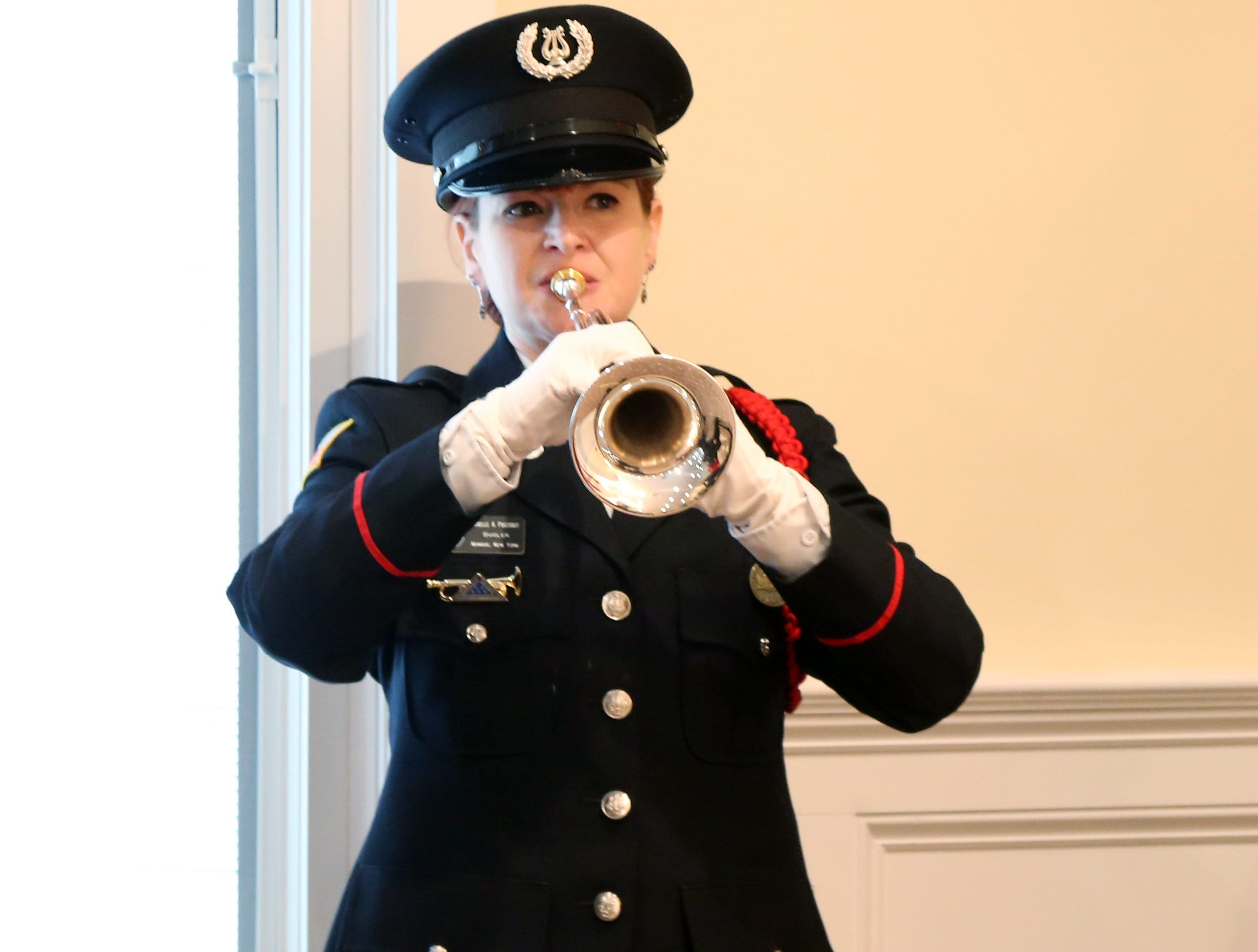 Michelle Poczobut plays taps during Thursday's memorial service for four veterans at Libby Funeral Home in Beacon on January 10, 2019. Poezobut is a member of Bugles Across America.