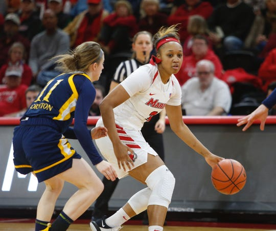 Marist's Alana Gilmer dribbles being defended by Quinnipiac's Edel Thornton on Thursday.