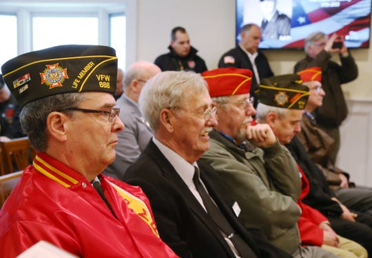 At left, Harold Delamater, commander of the Veterans of Foreign Wars post 666 in attendance of Thursday's memorial service for four veterans at Libby Funeral Home in Beacon on January 10, 2019.