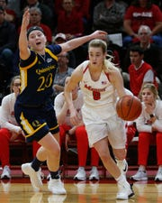 Marist's Grace Vander Weide dribbles away from Quinnipiac's Paige Warfel during Thursday's game.