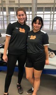Kaity Conte, left, and Leah Carvajal pose after taking first and fifth place, respectively, in the weight throw at the Freedom Games on Jan. 6.