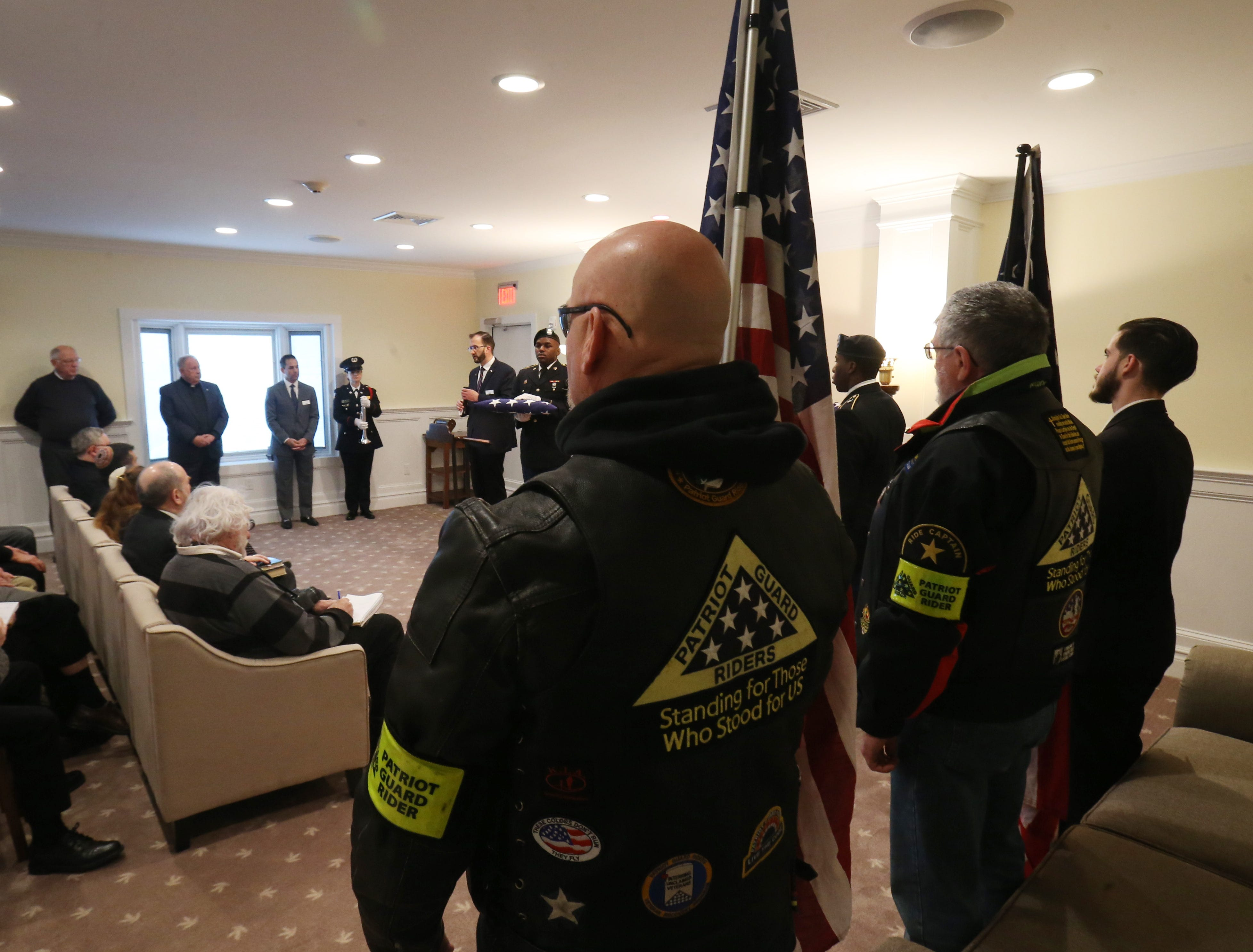 Patriot Guards, from left Ken Titland  and Bob Boisvert stand in attendance of Thursday's memorial service for four veterans at Libby Funeral Home in Beacon on January 10, 2019. The Patriot Guard accompanied the cremains on their way to Calverton National Cemetery on Long Island.