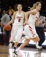 Marist College's Allie Best looks to pass to a teammate against Quinnipiac on Jan. 10.