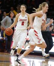 Marist College's Allie Best looks to pass to a teammate against Quinnipiac on Jan. 10.