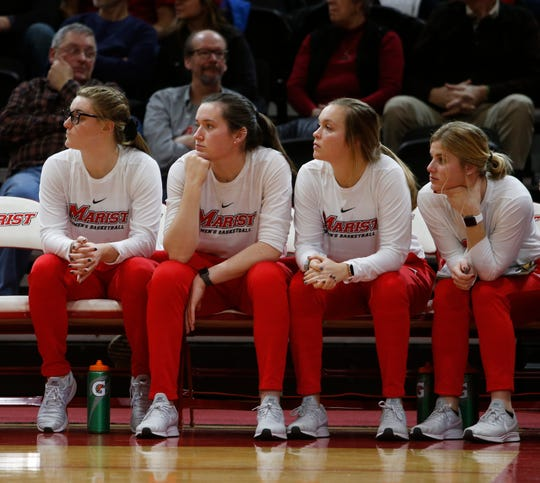 Marist's from left, Allie Clement, Maura Fitzpatrick, Hannah Hand, Claire Oberdorf sit out Thursday's game against Quinnipiac due to injuries.