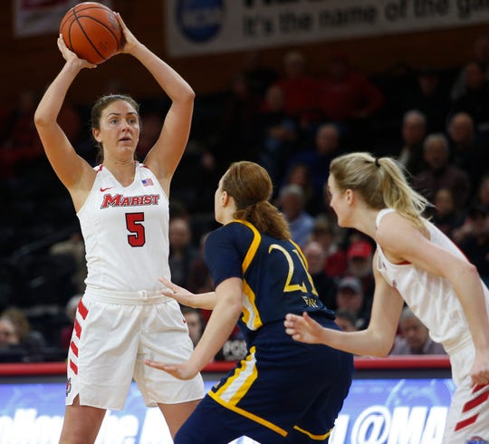 Marist's Lovisa Henningsdottir initiates a play as as Grace Vander Weide moves into position and Quinnipiac's Jen Fay covers her at McCann Arena on Jan. 10.