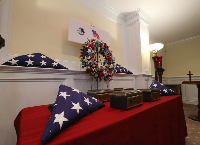 Flags and urns for four veterans who's cremains were in memorialized on Thursday at Libby Funeral Home in Beacon on January 10, 2019. The four cremains were in the funeral home's possession through several owners, and the current owners decided to hold the memorial service to pay respects to these veterans.