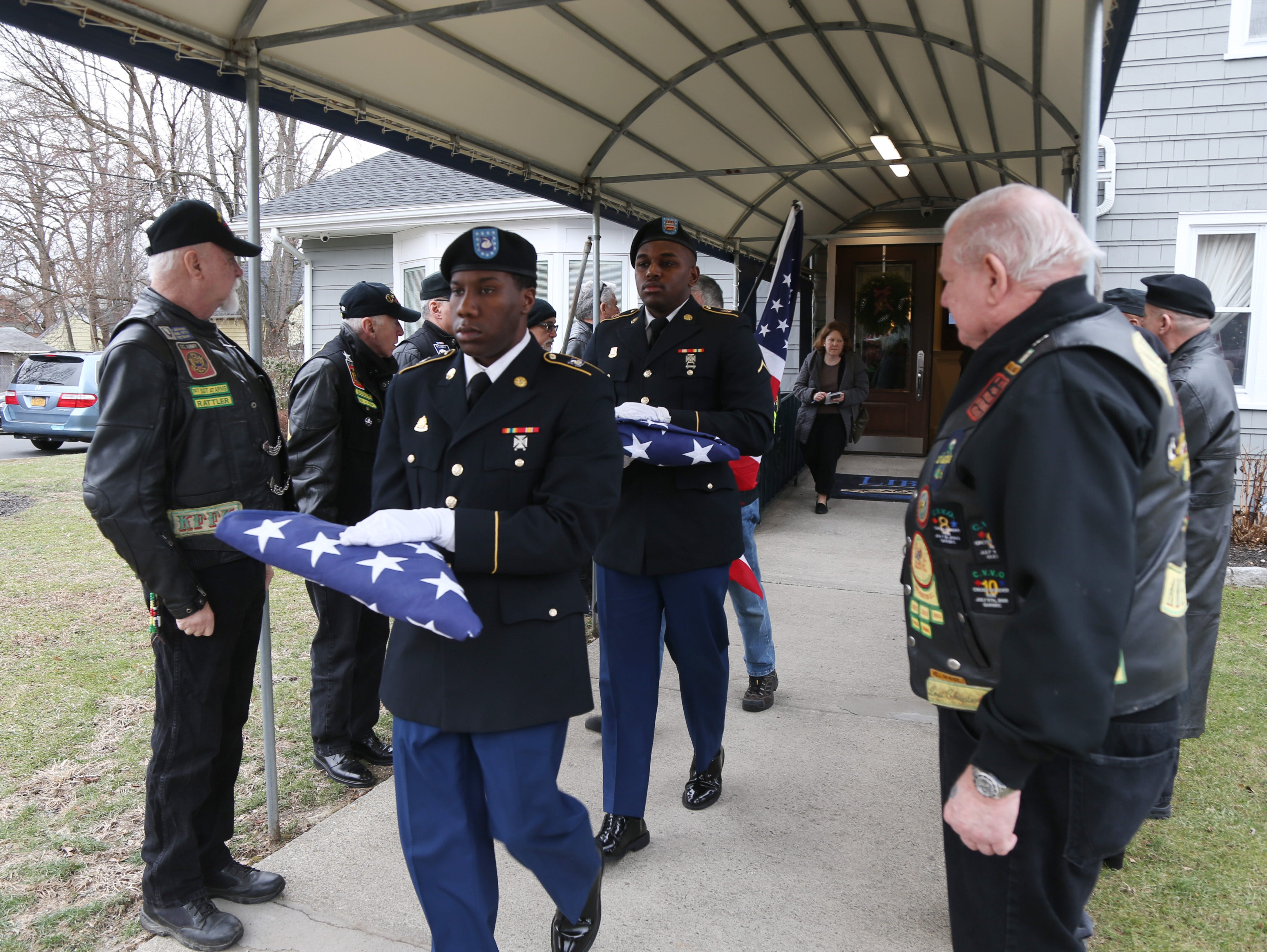 US Army honor guard carry the remains of four military veterans following Thursday's memorial service at Libby Funeral Home in Beacon on January 10, 2019.